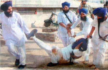 August 2006 photos of a GurSikh being attacked by SGPC 'task force'.