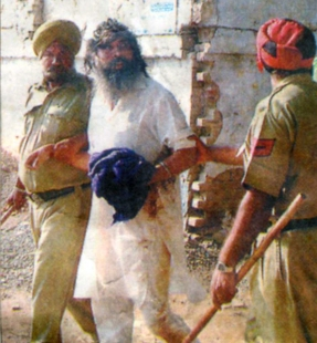 The same GurSikh is being escorted by the police after assaulted by SGPC 'task force'.