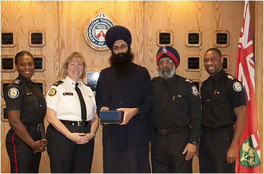 Balpreet Singh, WSO Legal Counsel, with Toronto Police Officials
