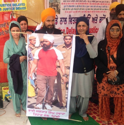 Bhai Gurbaksh Singh and Bibi Pritam Kaur (wife of Shaheed Rashpal Singh - Sant Jarnail Singh Ji's PA) holding up a poster of Babbar Jagtar Singh Hawara who is languishing in an Indian prison