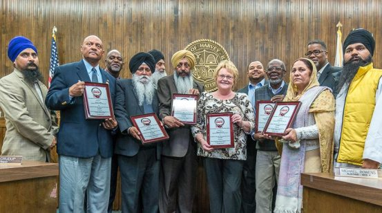 City of Harvey officials with representatives of Sikh organizations